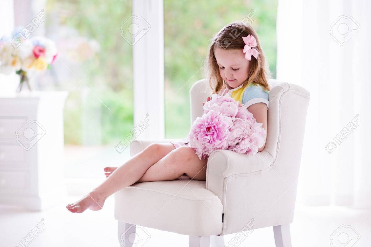 Little Girl Smelling Peony Flower Bouquet Sitting In A White Chair  # Muebles Sunnies