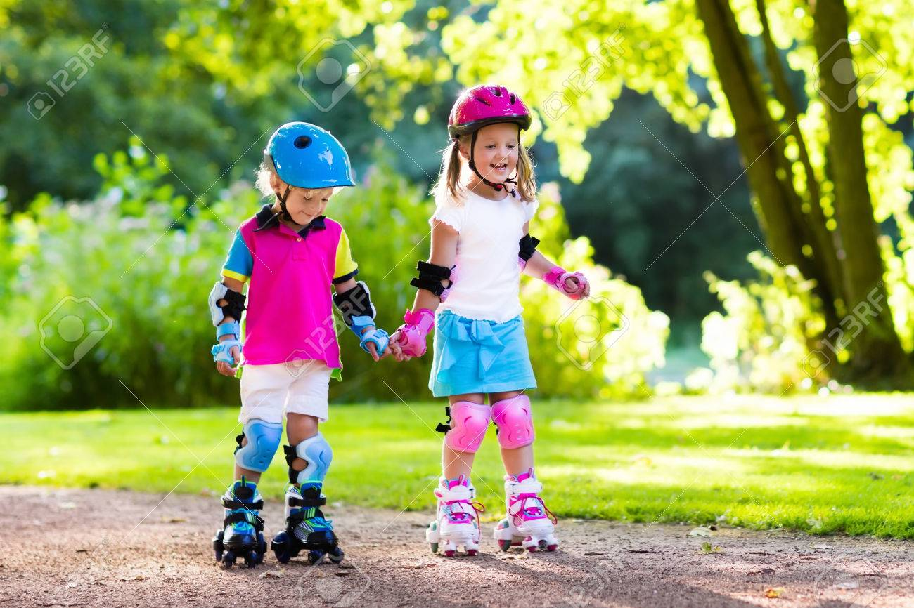 Girl And Boy Learn To Roller Skate In Summer Park Children Wearing Stock Photo Picture And Royalty Free Image Image 62299947