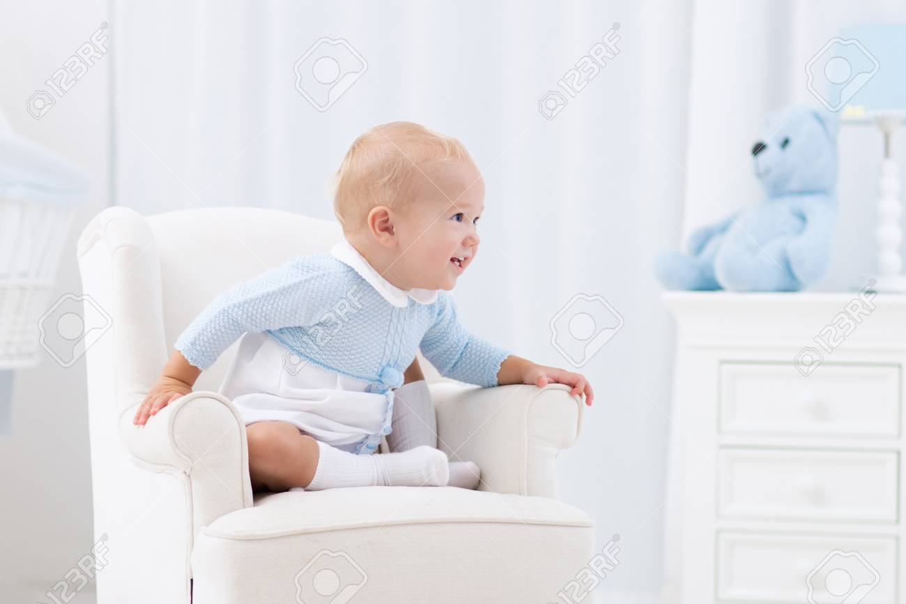 Adorable Baby Boy Playing In White Sunny Bedroom. Fotos, Retratos ...