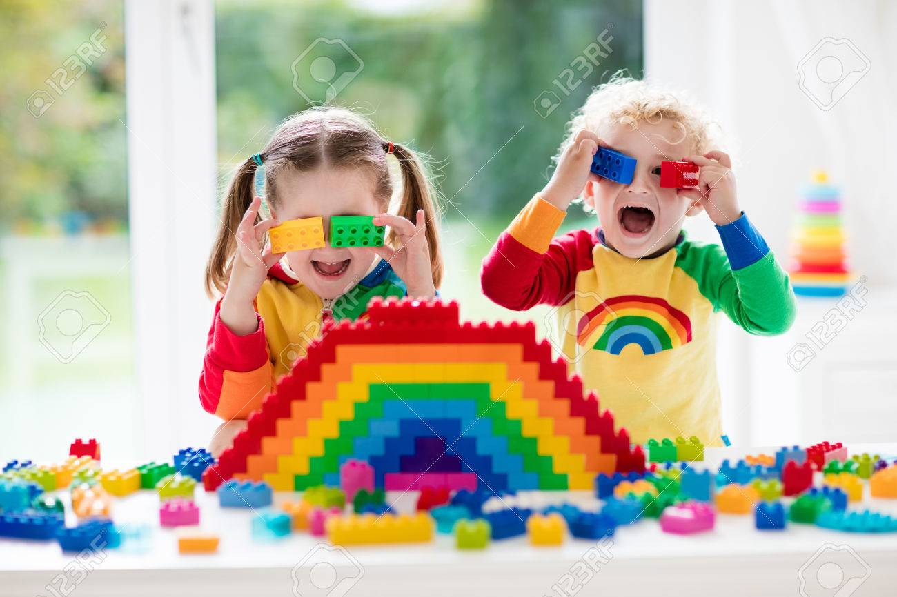 child playing with colorful toys little girl and funny curly baby boy with educational toy blocks children play at day care or preschool mess in kids room toddlers build a tower in kindergarten focus on girl - 71388237