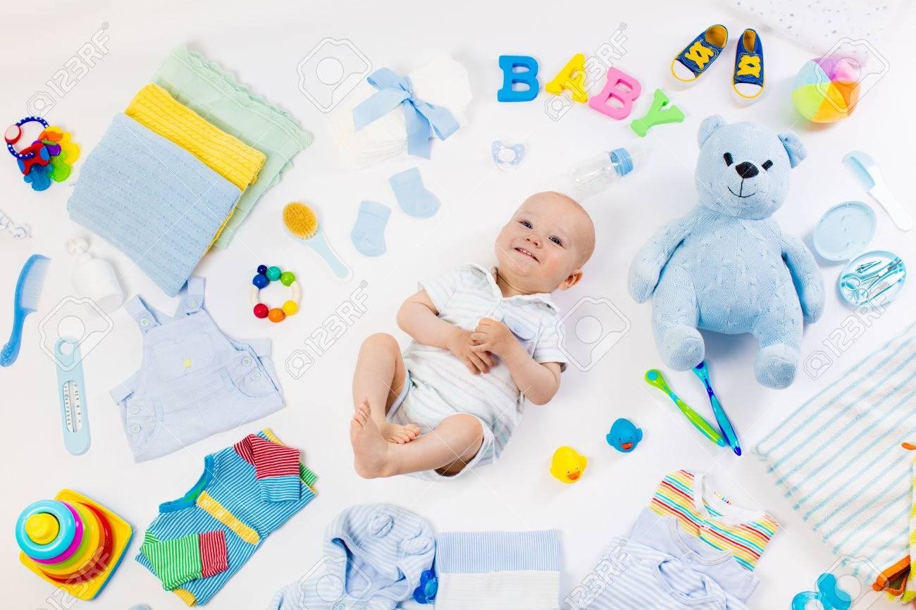 Baby On White Background With Clothing Toiletries Toys And Stock Photo Picture And Royalty Free Image Image 71397809