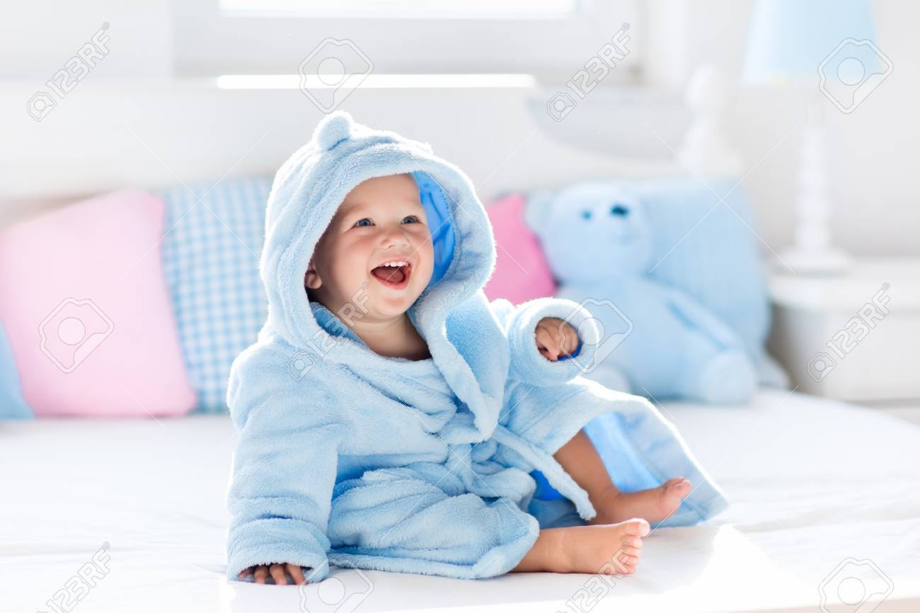 Cute Happy Laughing Baby Boy In Soft Bathrobe After Bath Playing ...