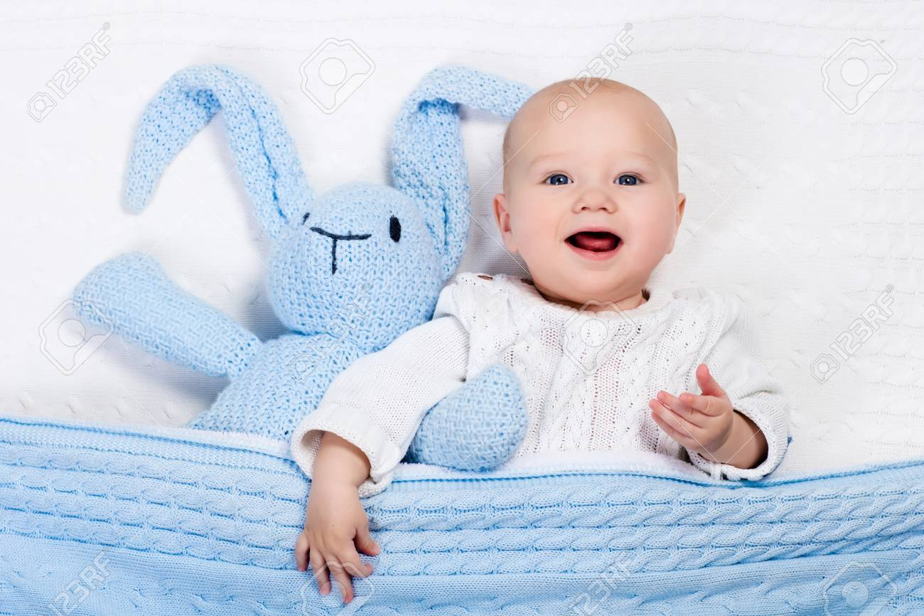eba23a0b29a7 Funny Little Baby Wearing A Warm Knitted Jacket Playing With.. Stock ...