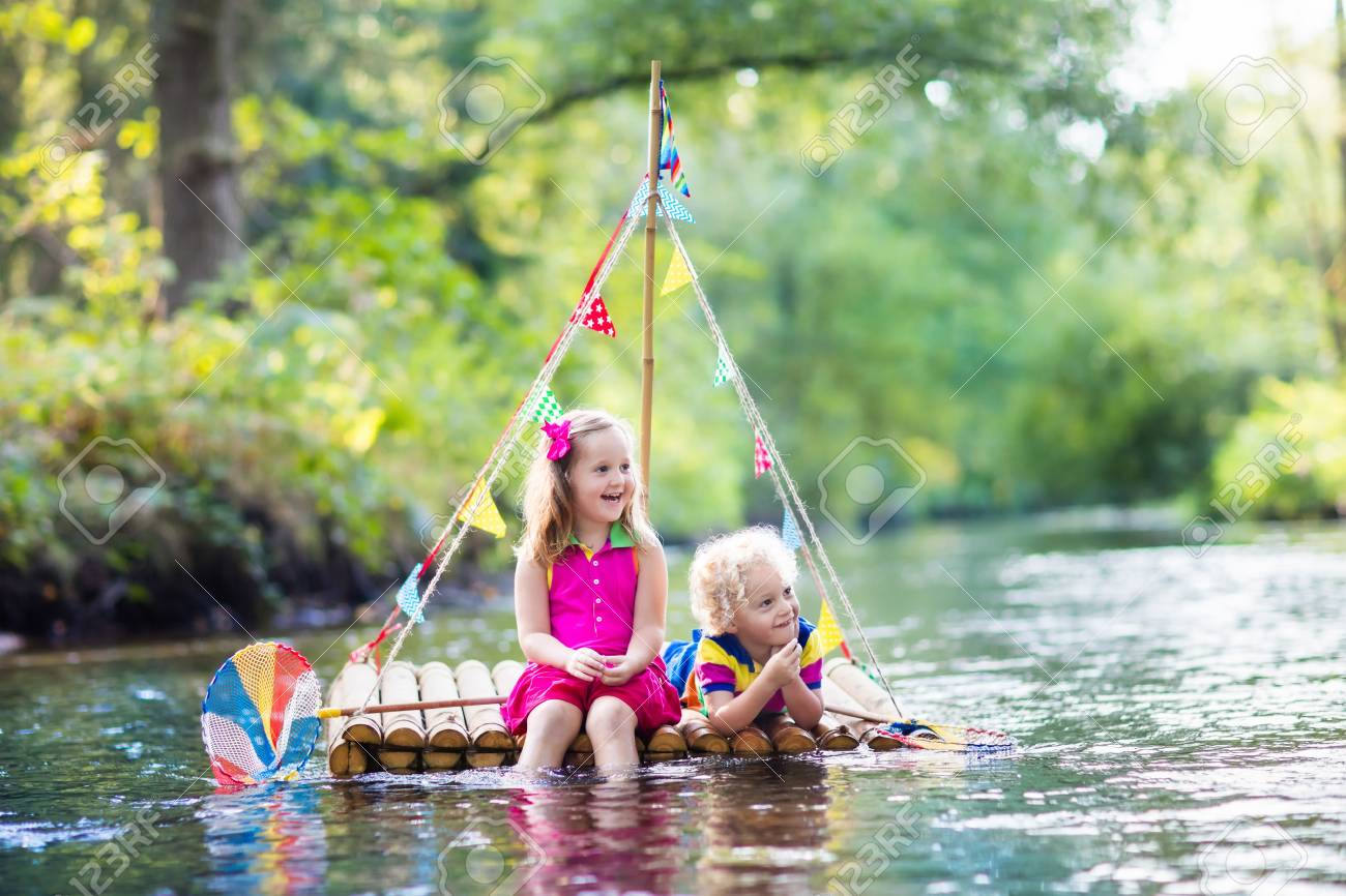 two children on wooden raft catching fish with a colorful net