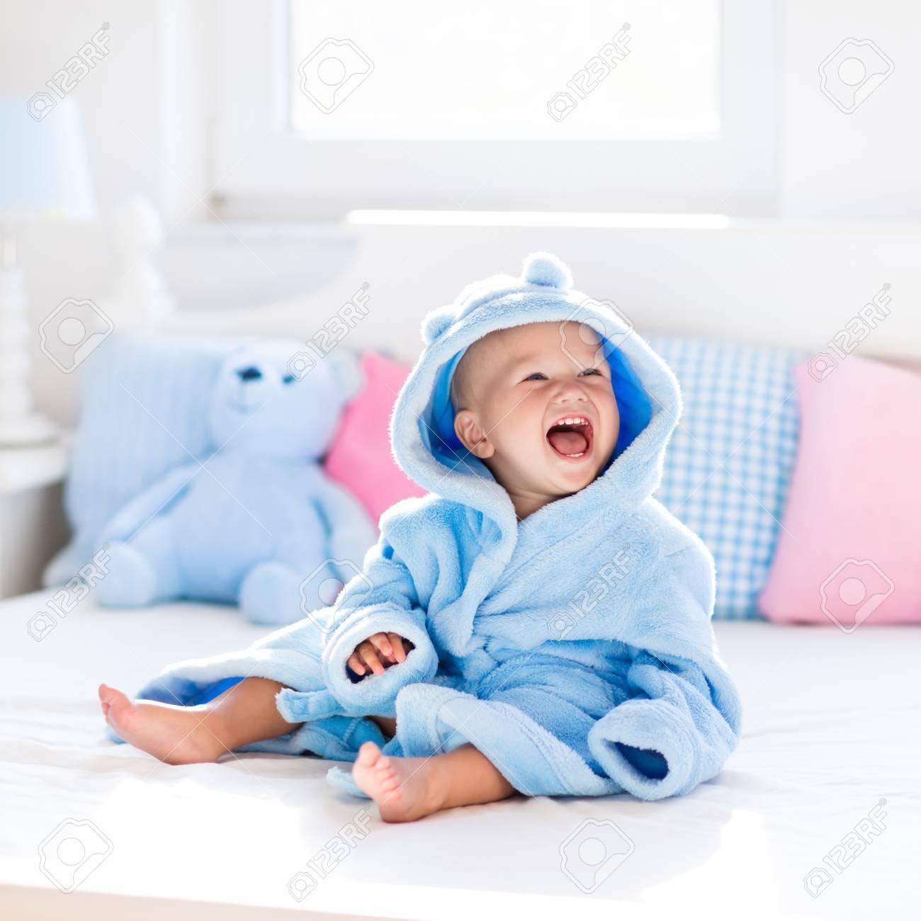 Cute Happy Laughing Baby Boy In Soft Bathrobe After Bath Playing ...
