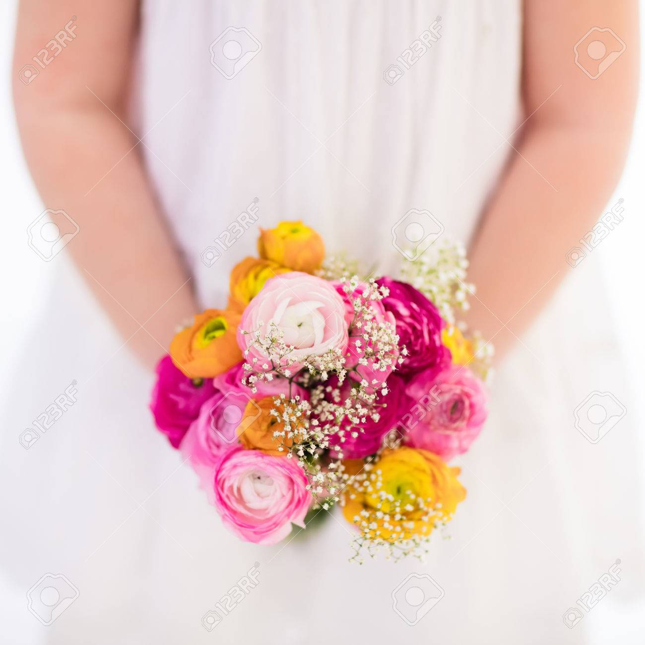 Cute Little Girl In White Dress Holding Ranunculus Flowers Bouquet ...