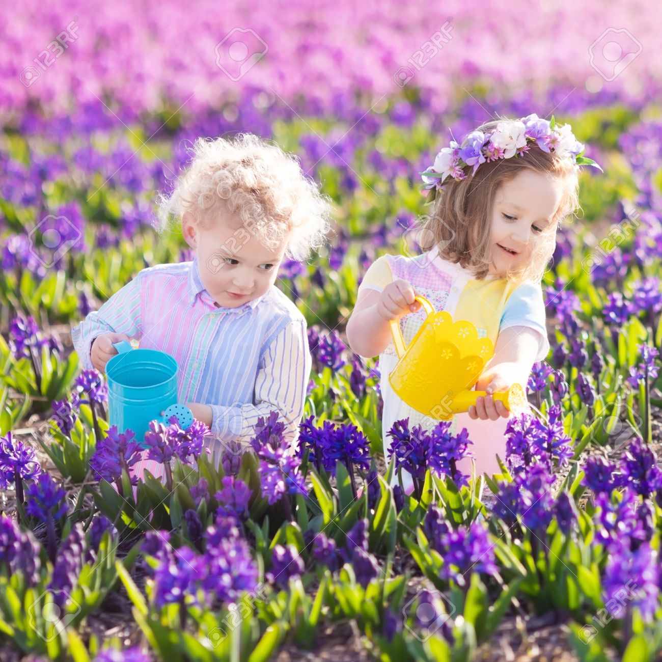 Children planting spring flowers in sunny garden little boy stock children planting spring flowers in sunny garden little boy and girl gardener plant hyacinth mightylinksfo