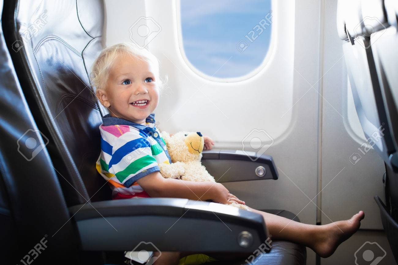 Child In Airplane. Kid In Air Plane Sitting In Window Seat. Flight ...