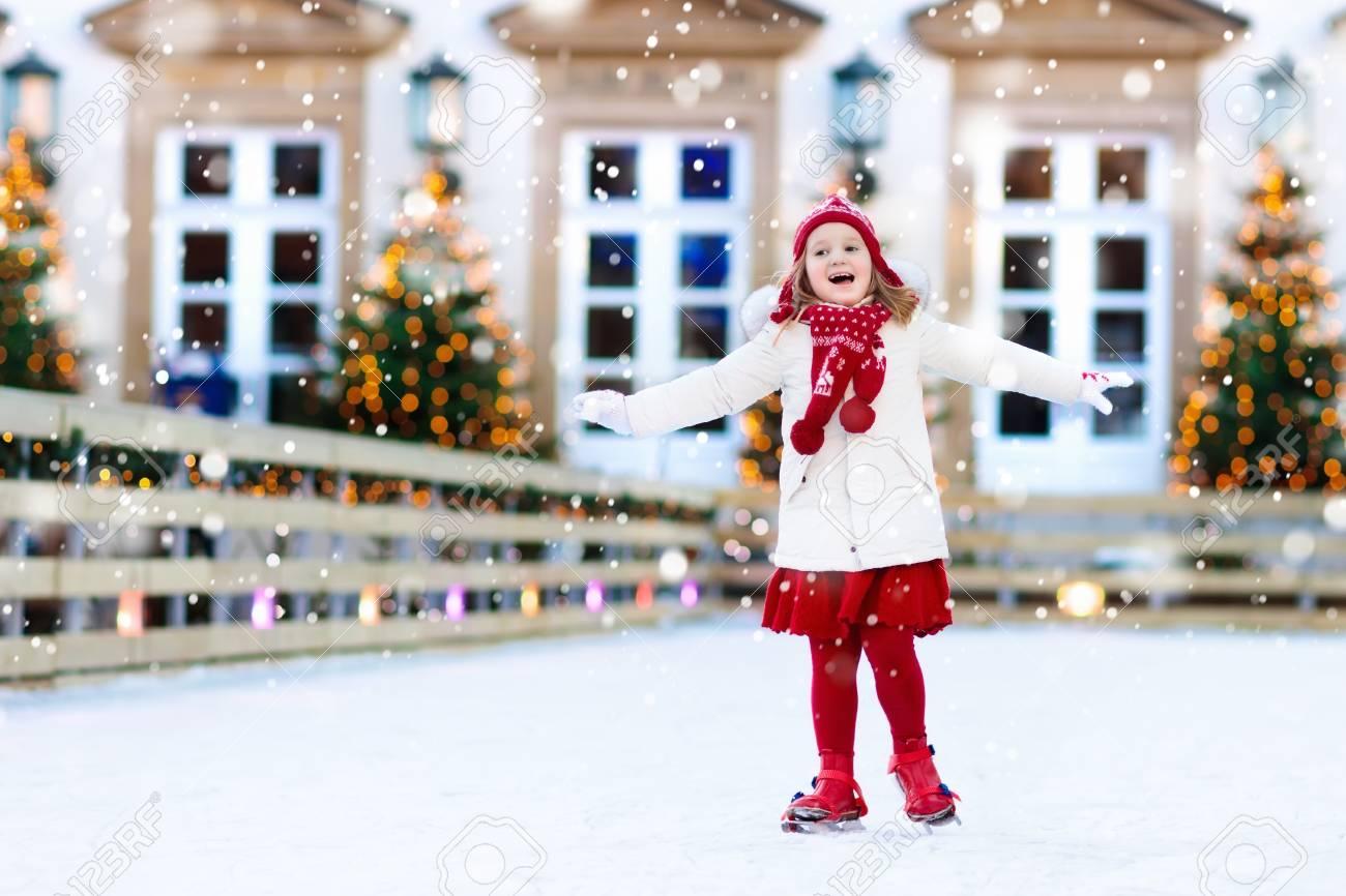 Christmas Ice Skating.Kids Ice Skating In Winter Park Rink Children Ice Skate On Christmas
