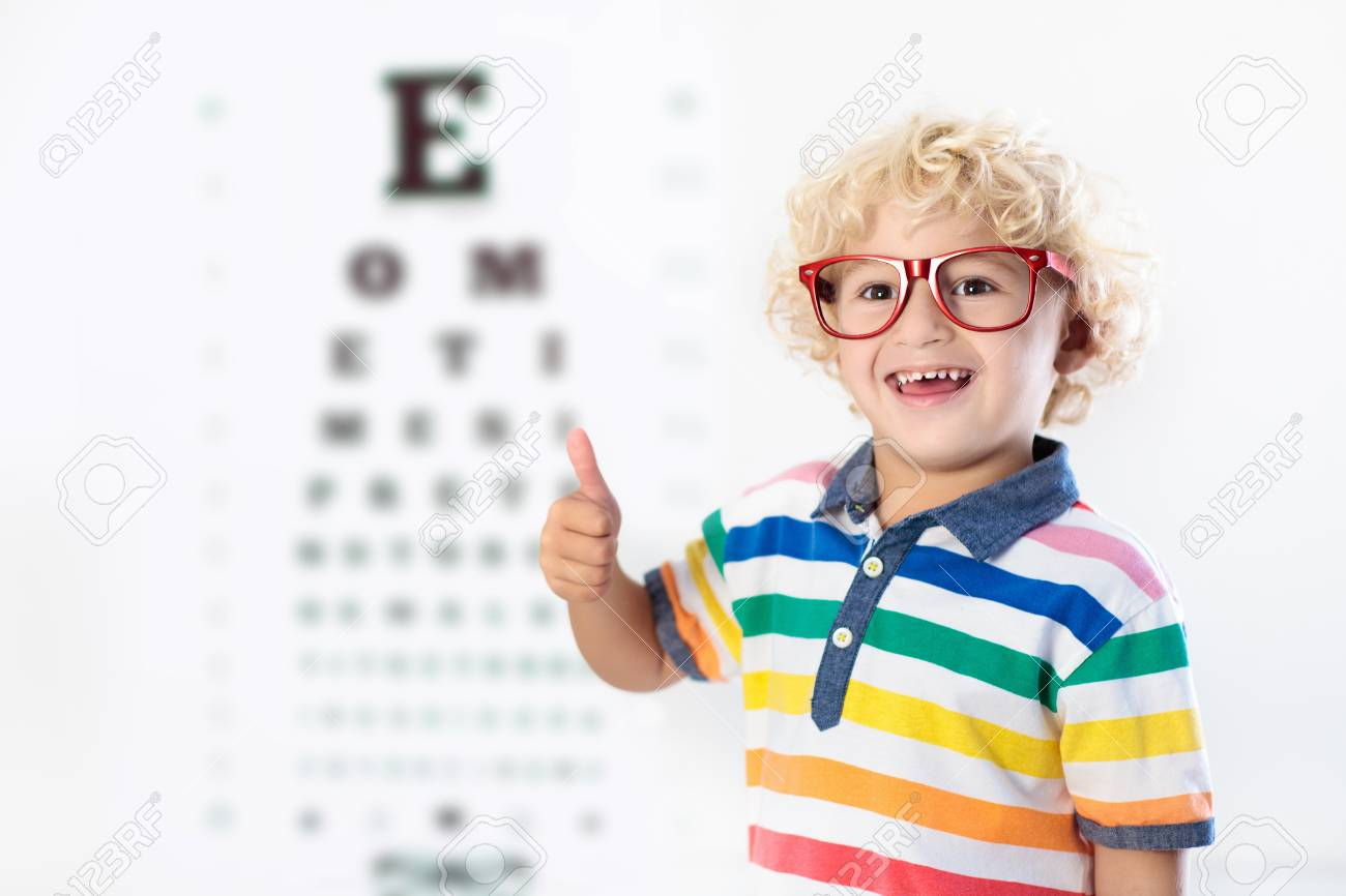 Child at eye sight test little kid selecting glasses at optician child at eye sight test little kid selecting glasses at optician store eyesight measurement geenschuldenfo Images