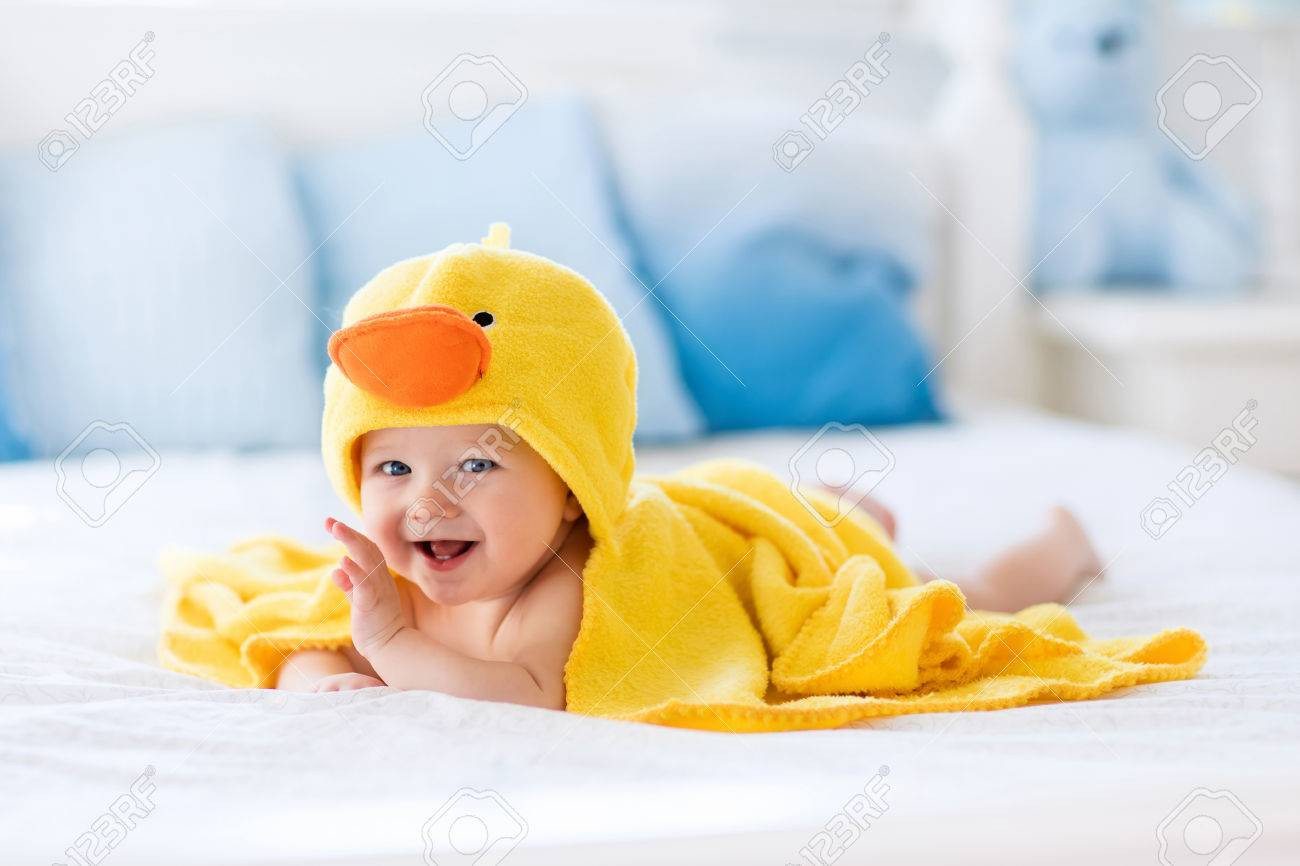 2ca5dd743 Happy Laughing Baby Wearing Yellow Hooded Duck Towel Sitting.. Stock ...
