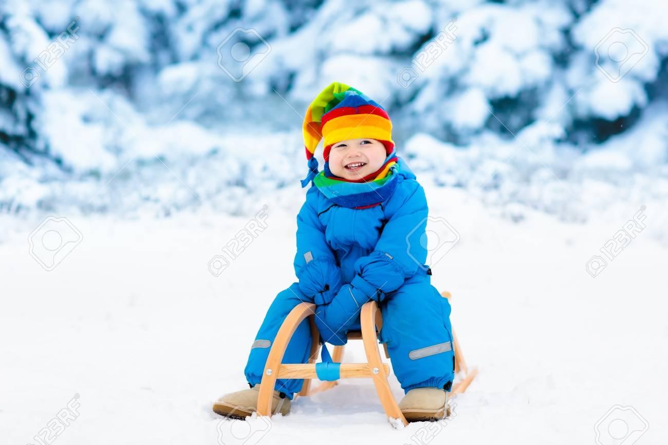 Christmas Vacation Sled.Little Boy Enjoying A Sleigh Ride Child Sledding Toddler Kid