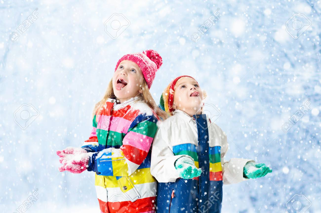 33a38bf5c758 Kids Playing In Snow. Children Play Outdoors On Snowy Winter.. Stock ...