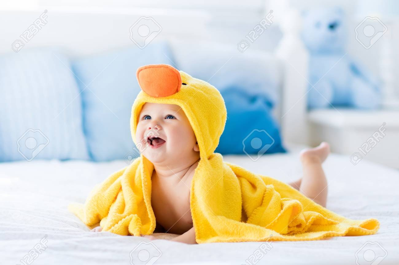 Happy Laughing Baby Wearing Yellow Hooded Duck Towel Sitting.. Stock ...