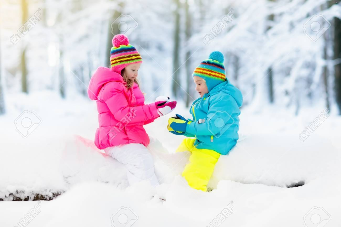 Kids playing in snow Children play outdoors