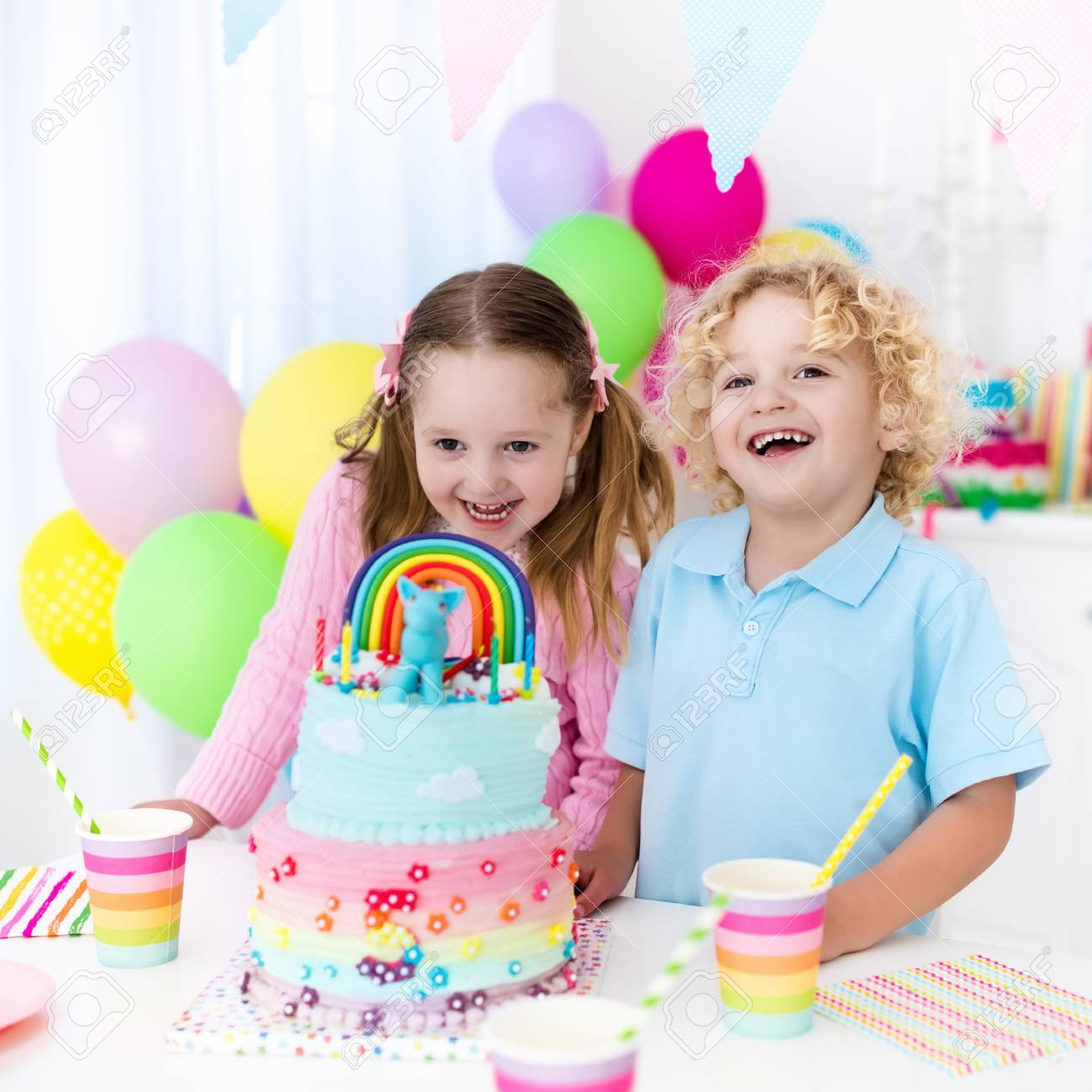 Kids Birthday Party With Colorful Pastel Decoration And Rainbow