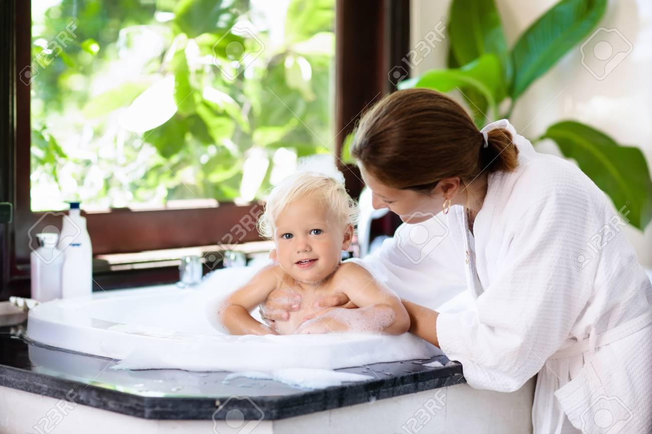 Little Child Taking A Bubble Bath In A Beautiful Bathroom With ...