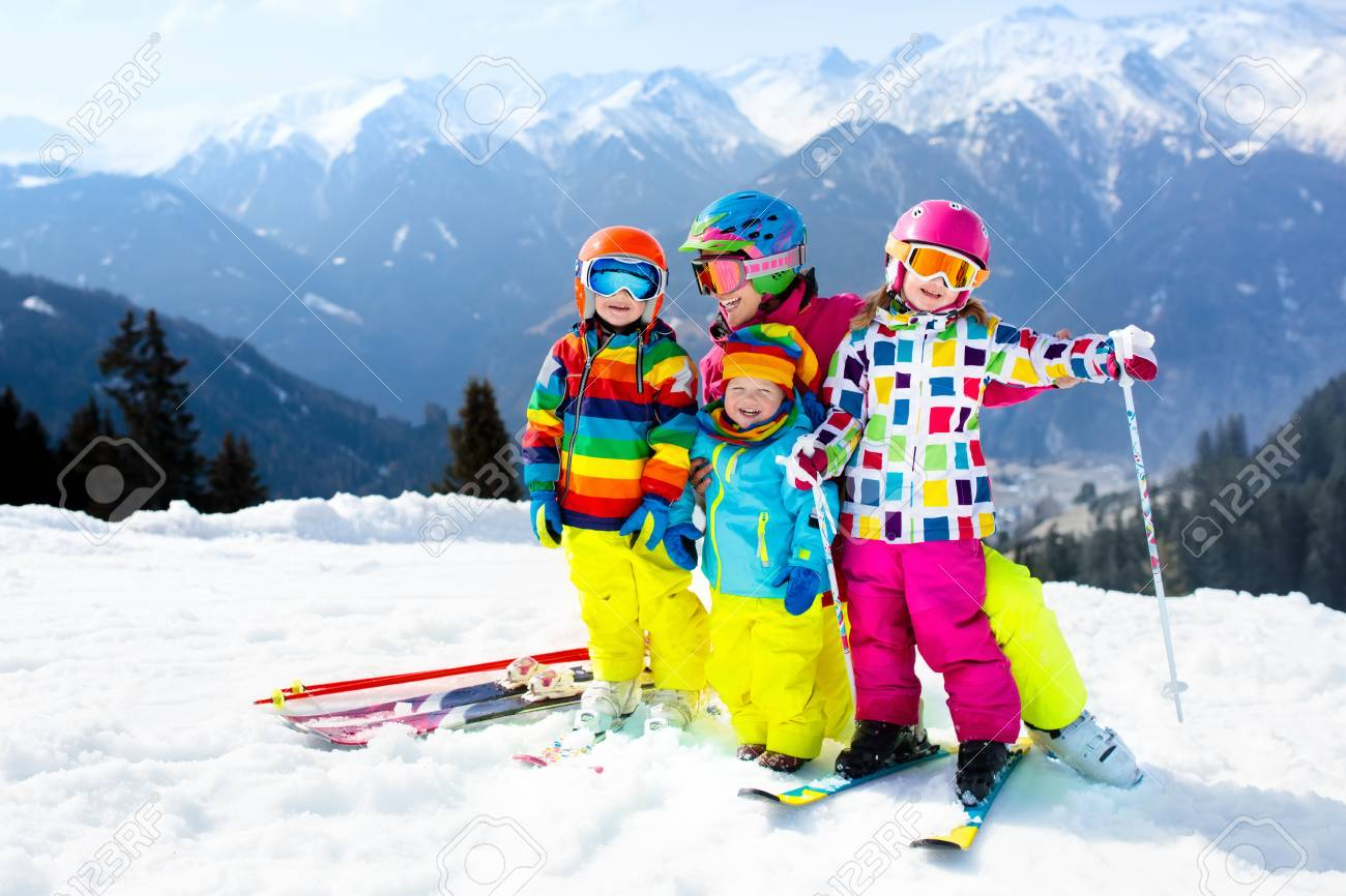 f7aec408cd3f Family Ski Vacation. Group Of Young Skiers In The Alps Mountains ...
