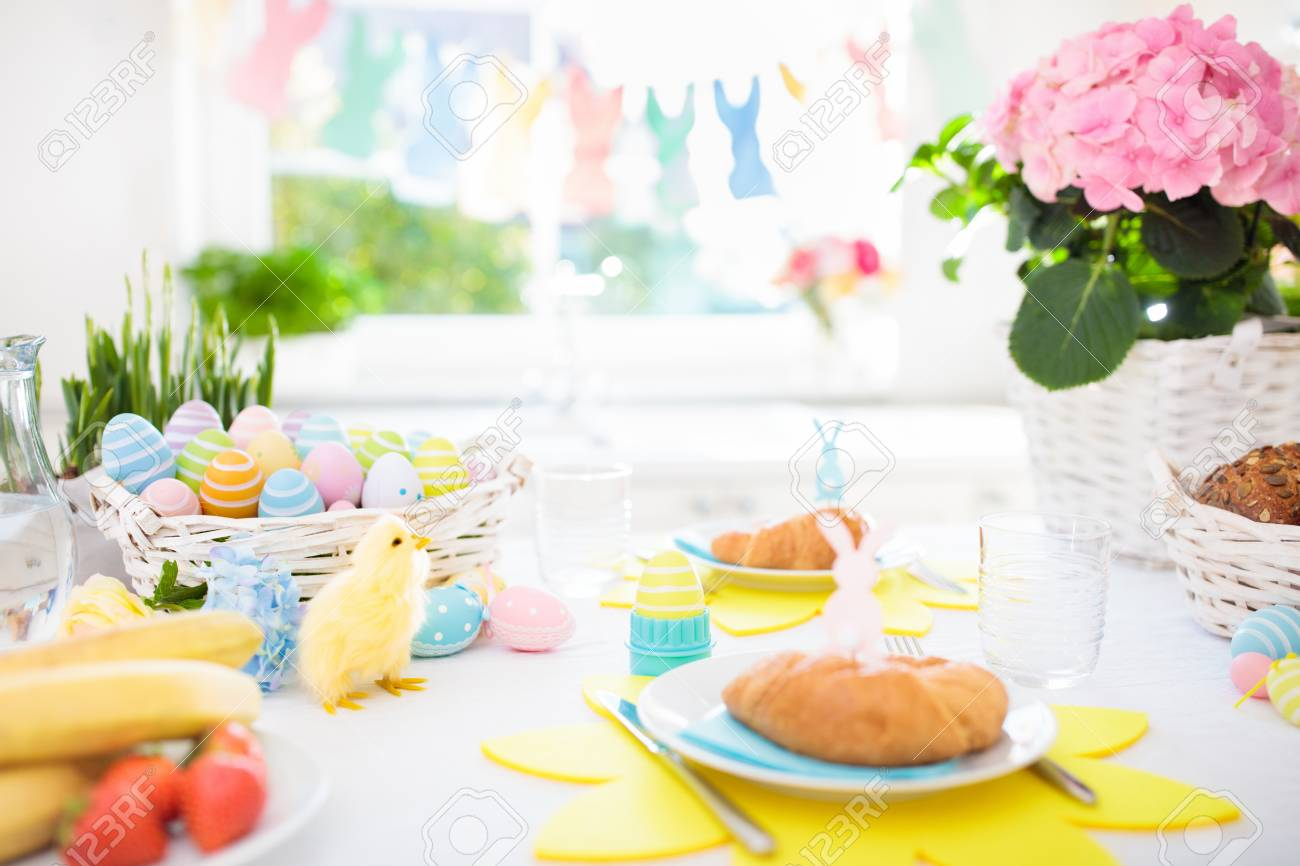 Easter breakfast table setting. Decoration for Easter family celebration. Eggs basket and spring flowers & Easter Breakfast Table Setting. Decoration For Easter Family.. Stock ...