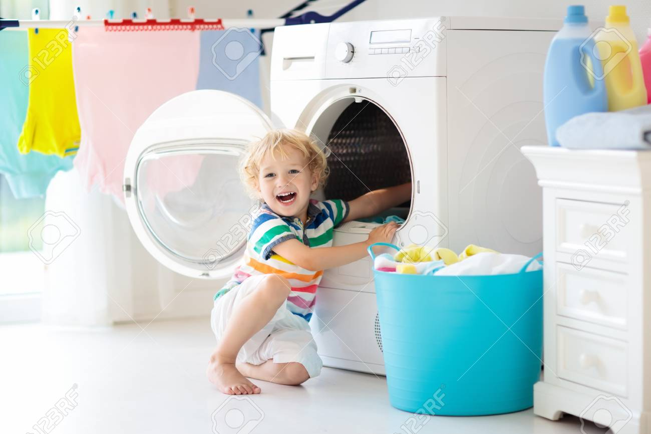 child laudry room Kids In Laundry Room With Washing Machine Stock Image ...