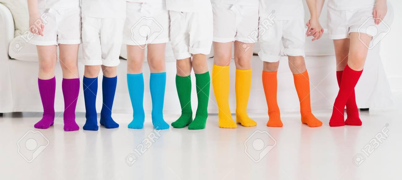 b5aaef96d45 Kids wearing colorful rainbow socks. Children footwear collection...