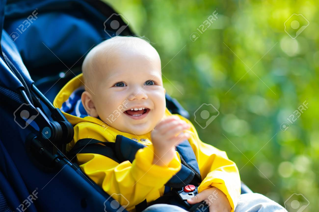 9d0e5054b Baby In Stroller On A Walk In Autumn Park. Adorable Little Boy ...