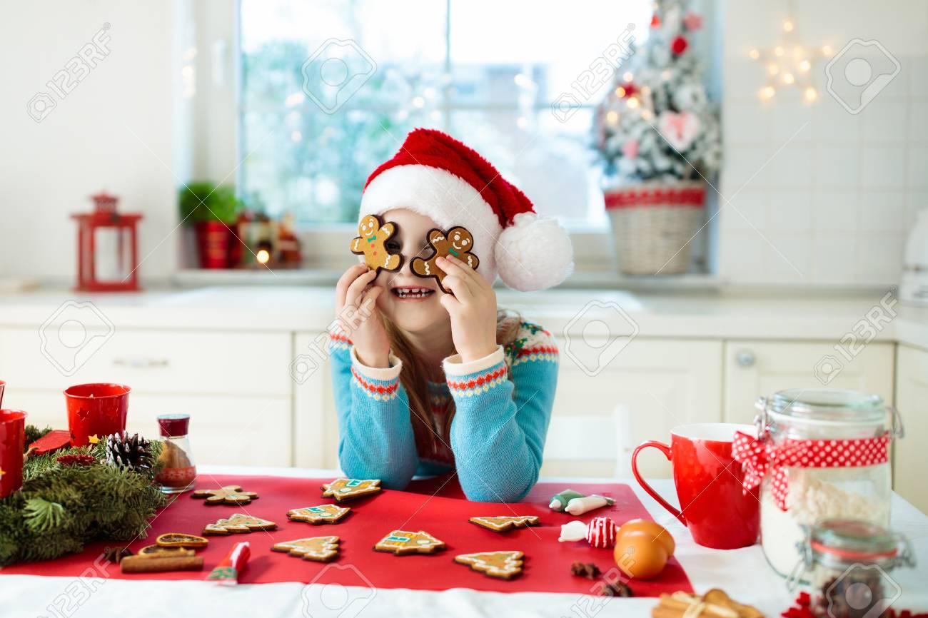 Kids Bake Christmas Cookies Child In Santa Hat Cooking Decorating
