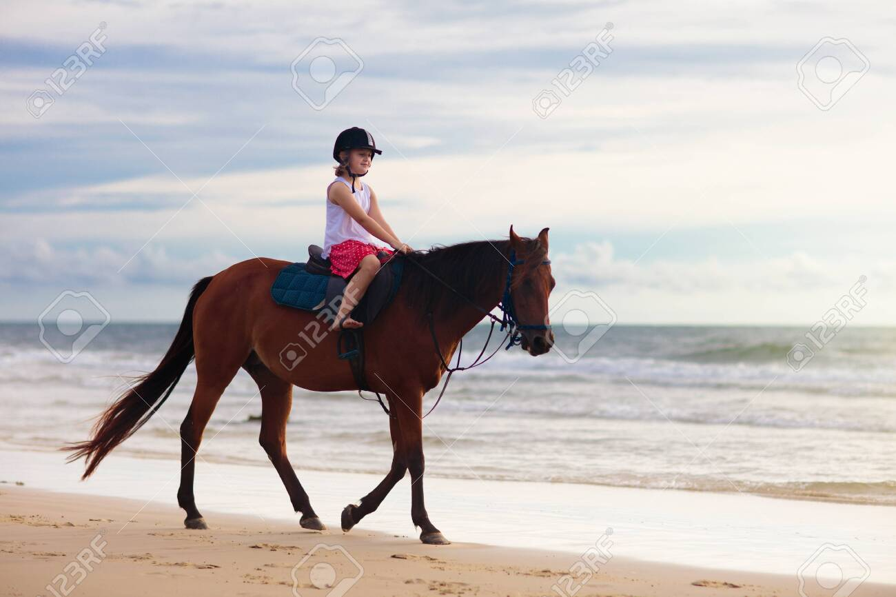 Kids Riding Horse On Beach Children Ride Horses Cute Little Stock Photo Picture And Royalty Free Image Image 127843974