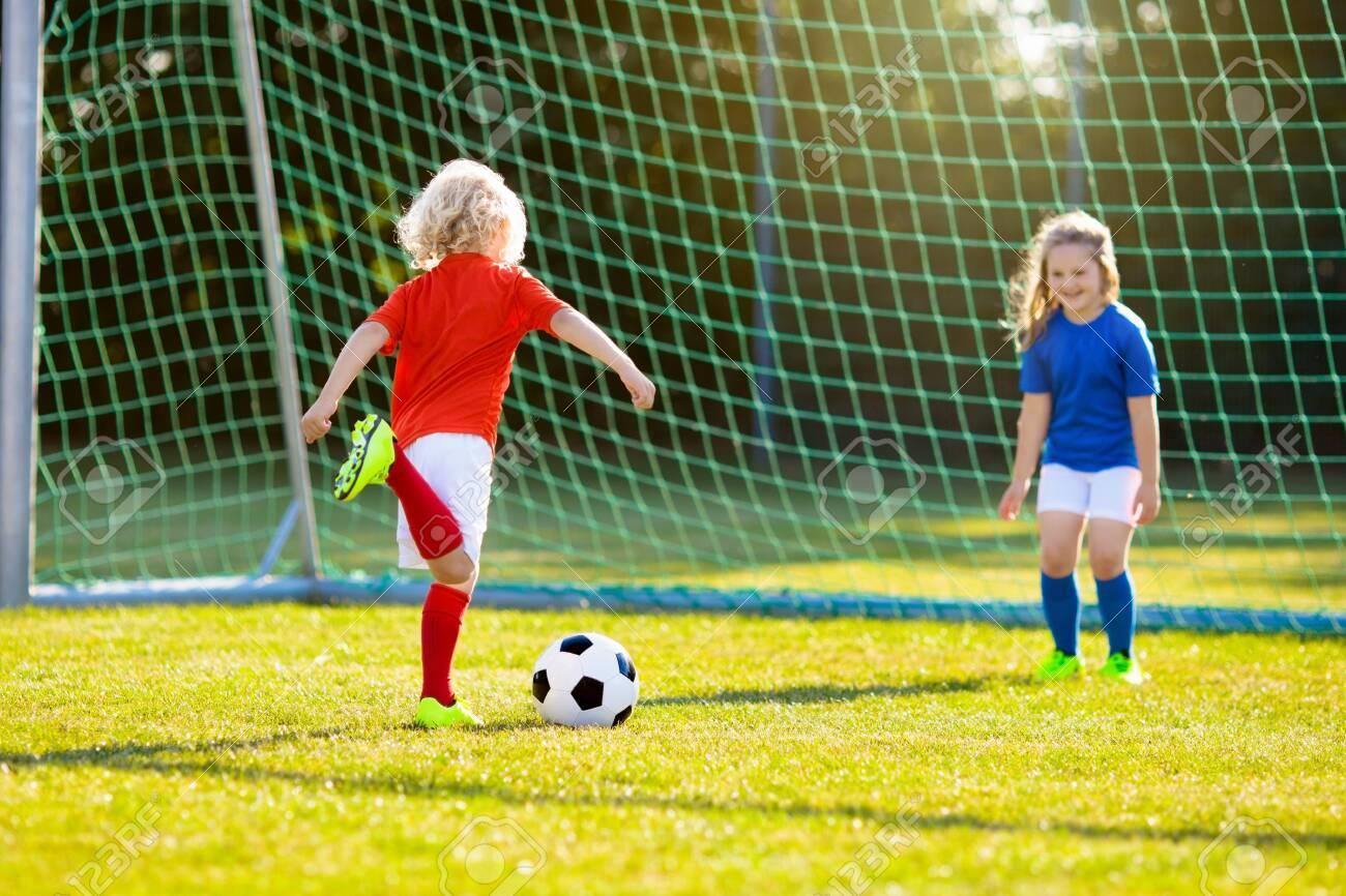 Kids Play Football On Outdoor Field. Children Score A Goal At ...