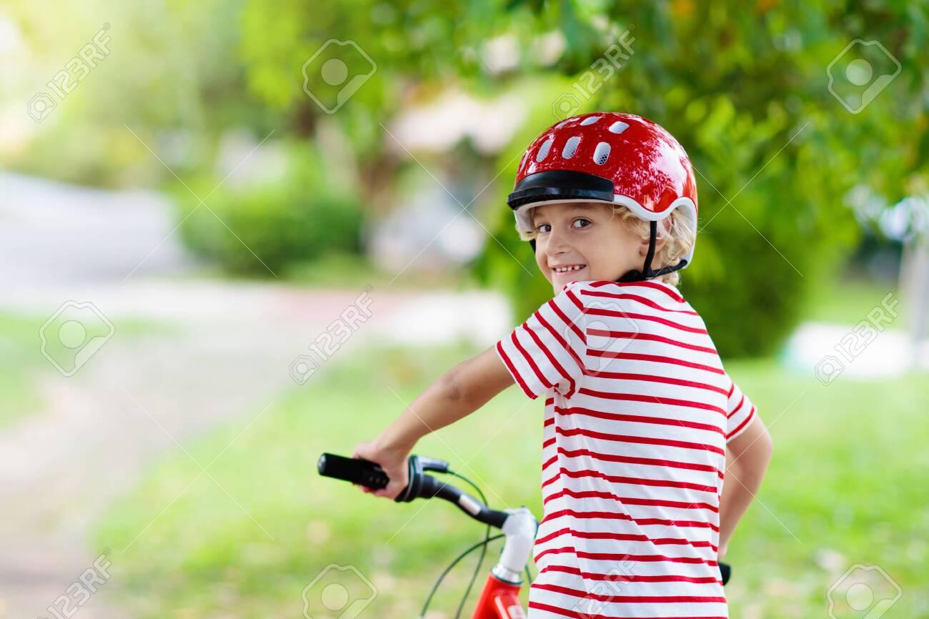 dirt cheap offer discounts pretty cheap Kids On Bike In Park. Children Going To School Wearing Safe ...