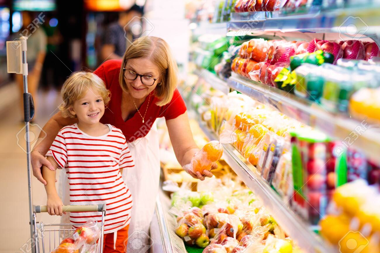 Shopping With Kids Mother And Child Buying Fruit In Supermarket Stock Photo Picture And Royalty Free Image Image 142448610