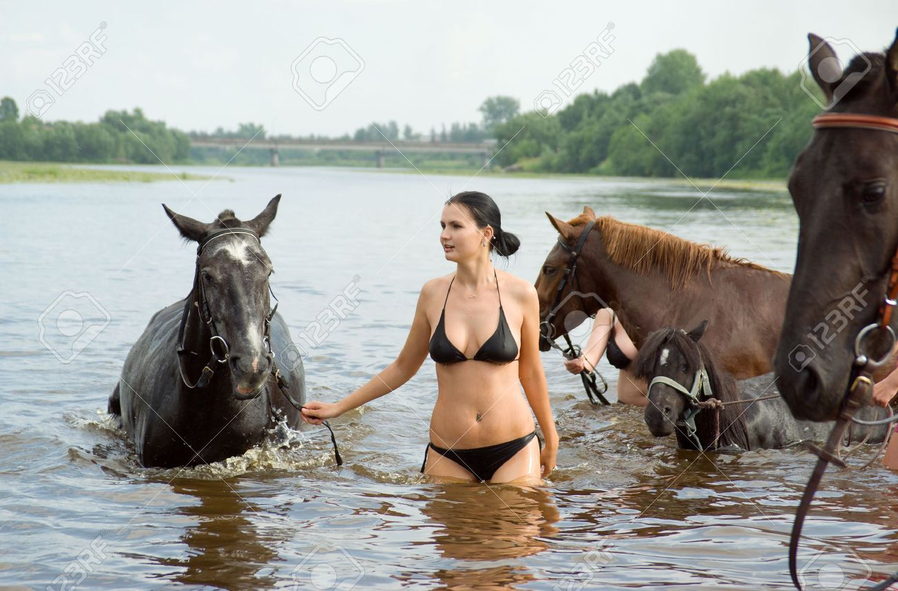 young girl bathe horse in a river. Stock Photo - 5352208