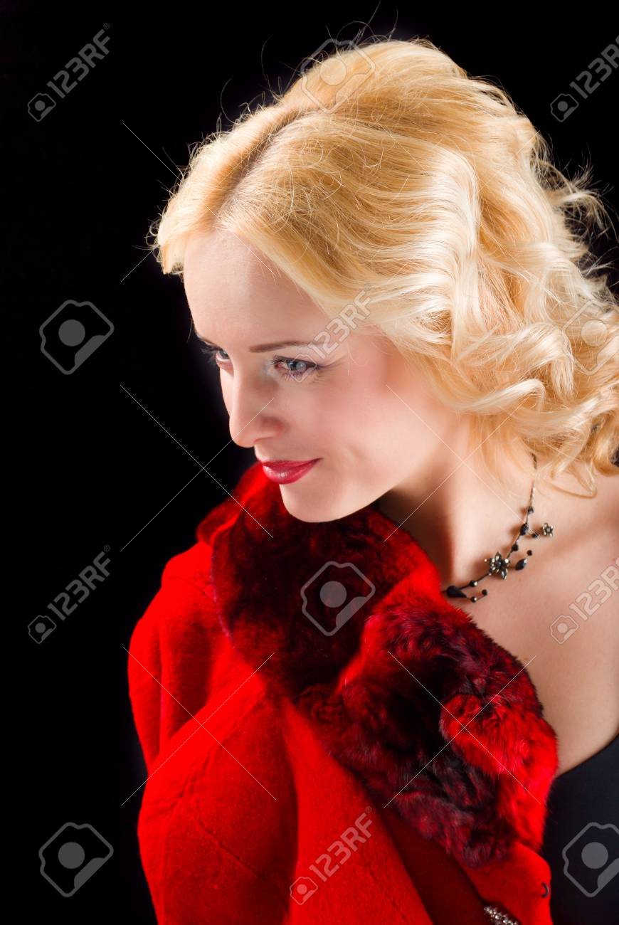 Sexy model wearing winter fur red  coat on  black  background Stock Photo - 6787979
