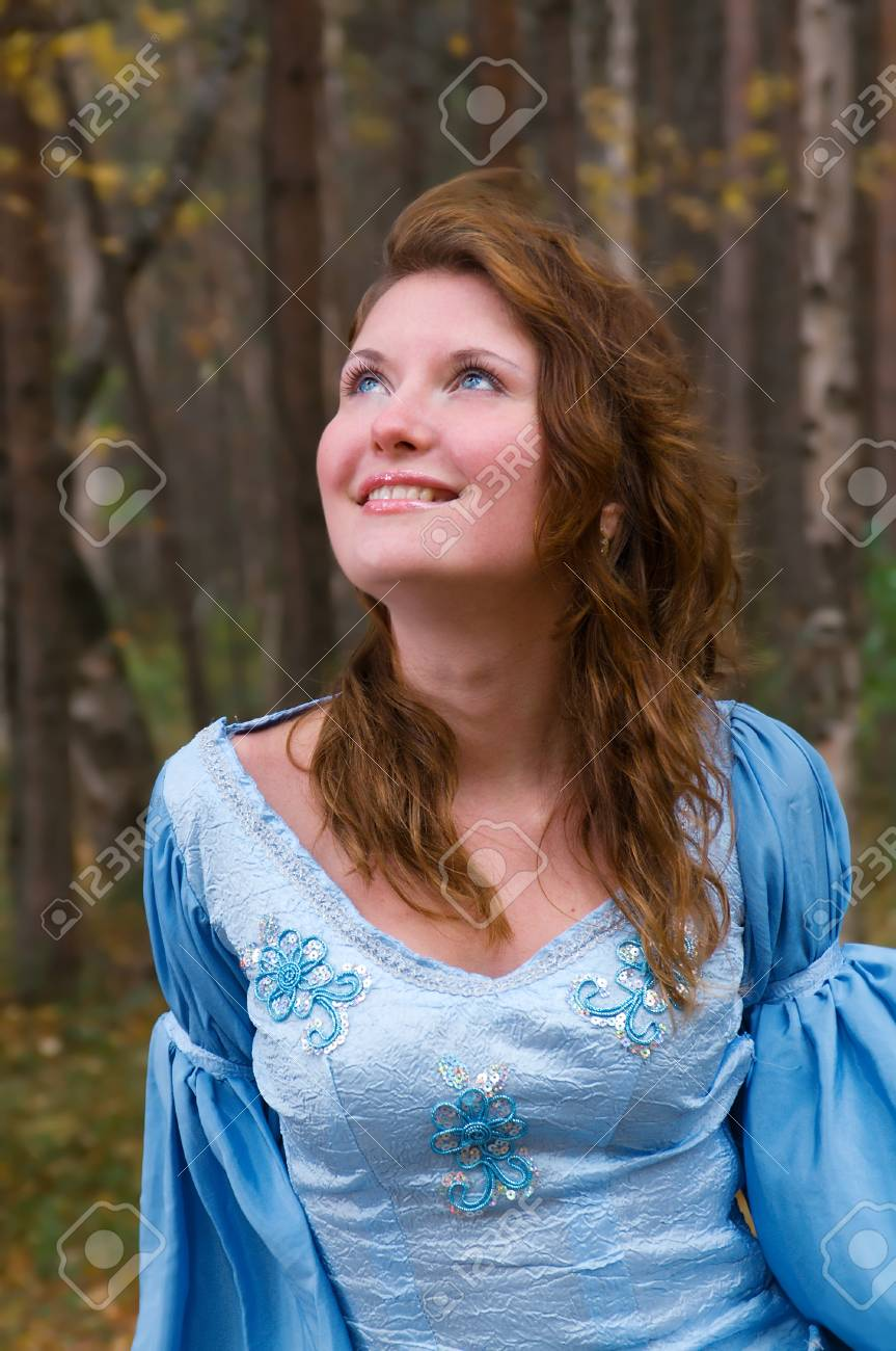 Very beautiful girl in medieval dress in autumn wood. Stock Photo - 7955535