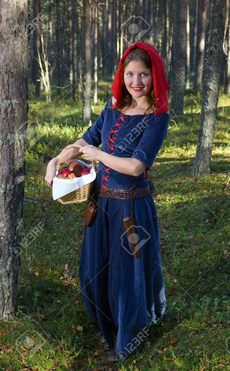 red Riding  hood standing in a wood . beautiful girl in medieval dress Stock Photo - 7955542