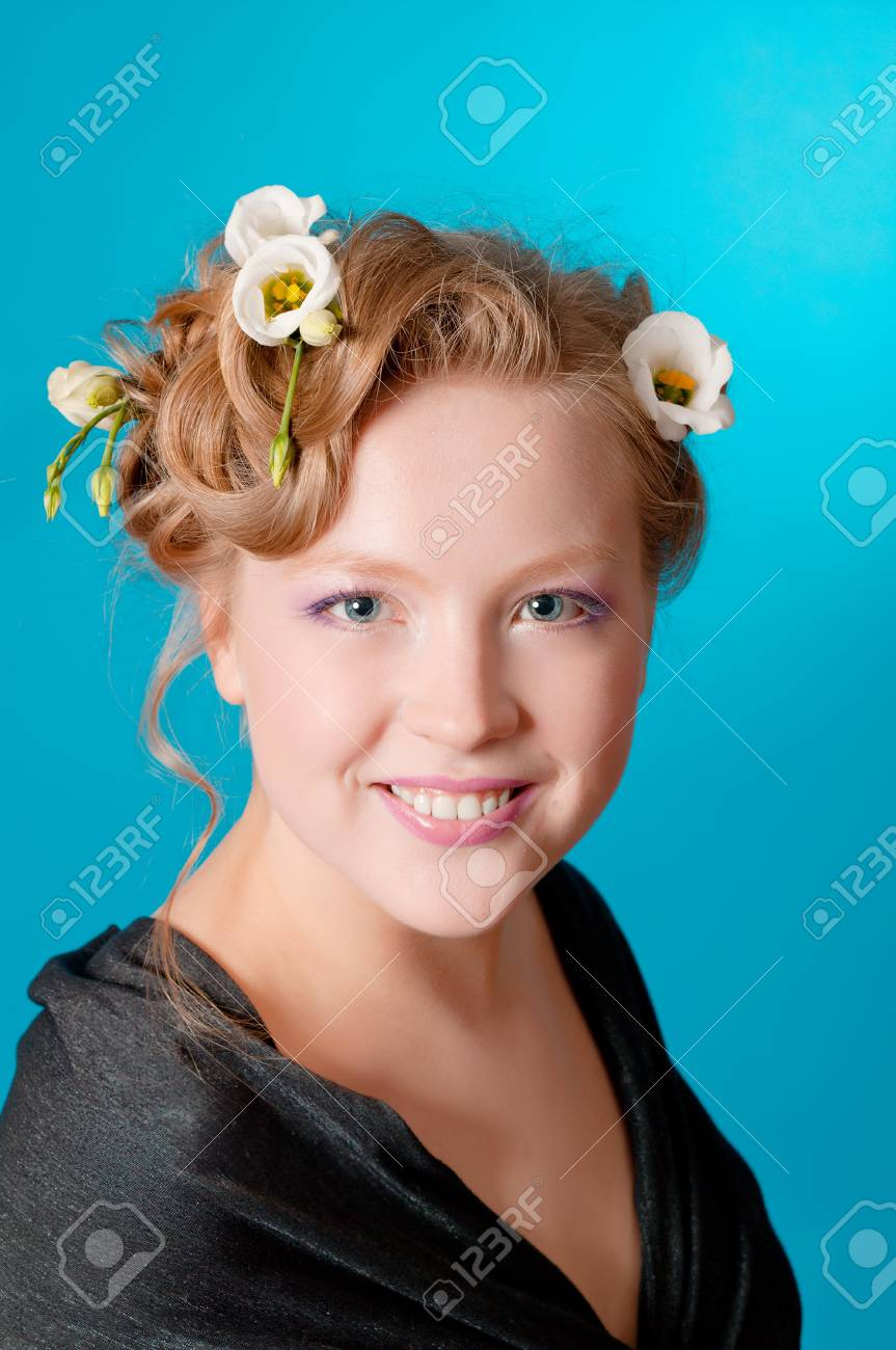 Portrait Of Beautiful Girl Blonde With Flowers In Her Hair Stock