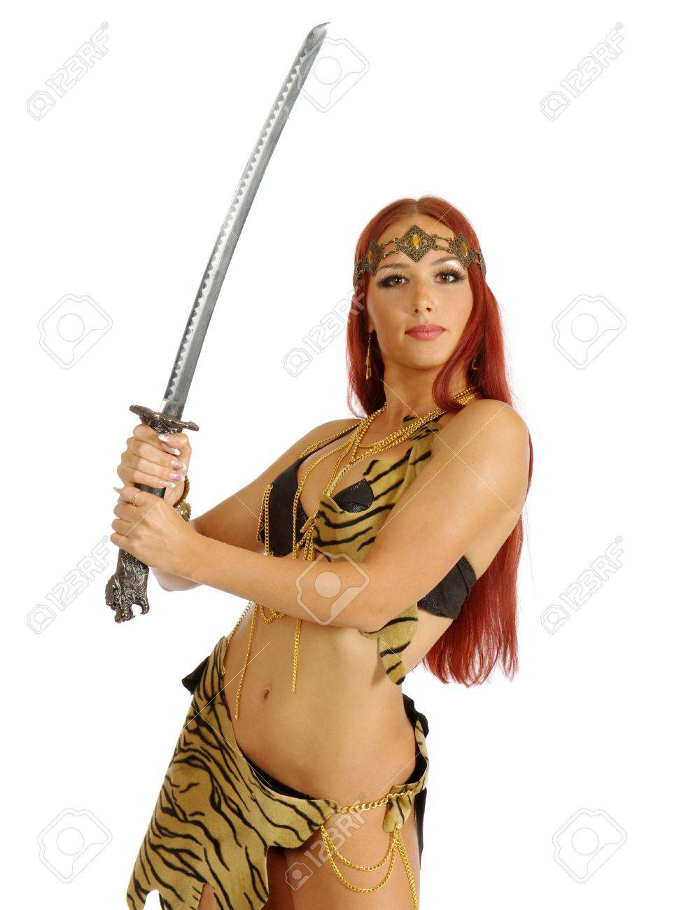 young warrior woman holding sword in her hand isolated on white background Stock Photo - 10372126