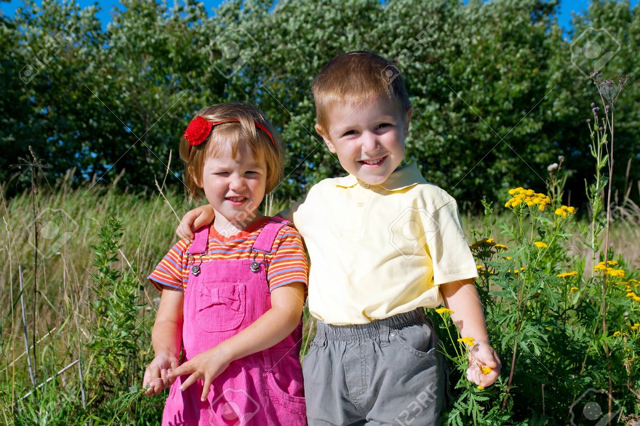 happy sister and brother  on the meadow Stock Photo - 10599720