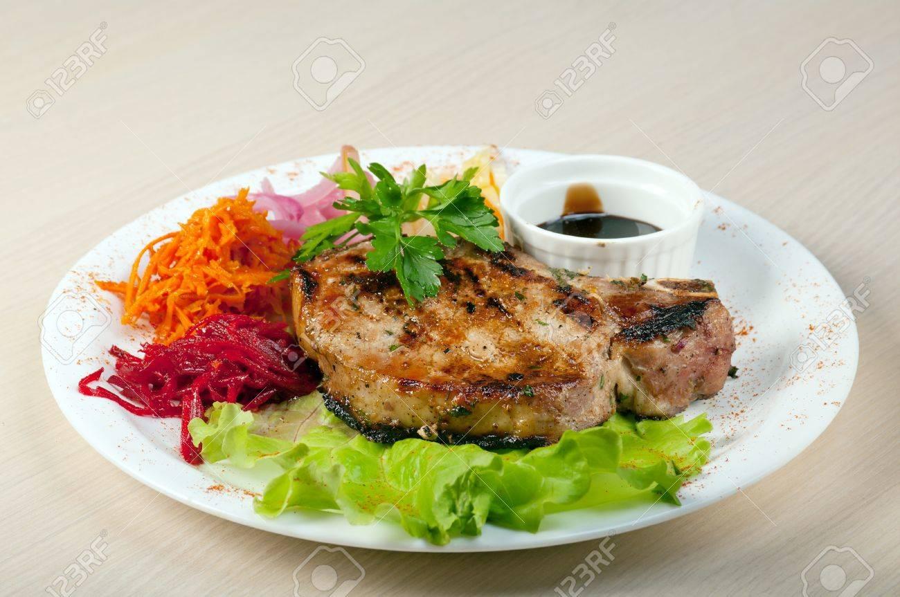 grilled t-bone pork steak and vegetables Stock Photo - 10599684