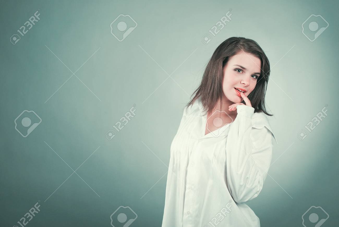 Young beautiful woman on gray background. copyspace Stock Photo - 13676412