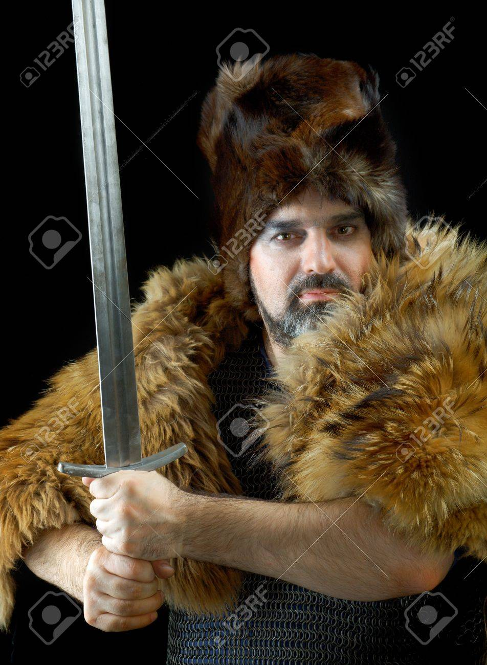 Cimmerian.barbarian  Warrior.Medieval knight in the armor with the sword. Stock Photo - 13842869
