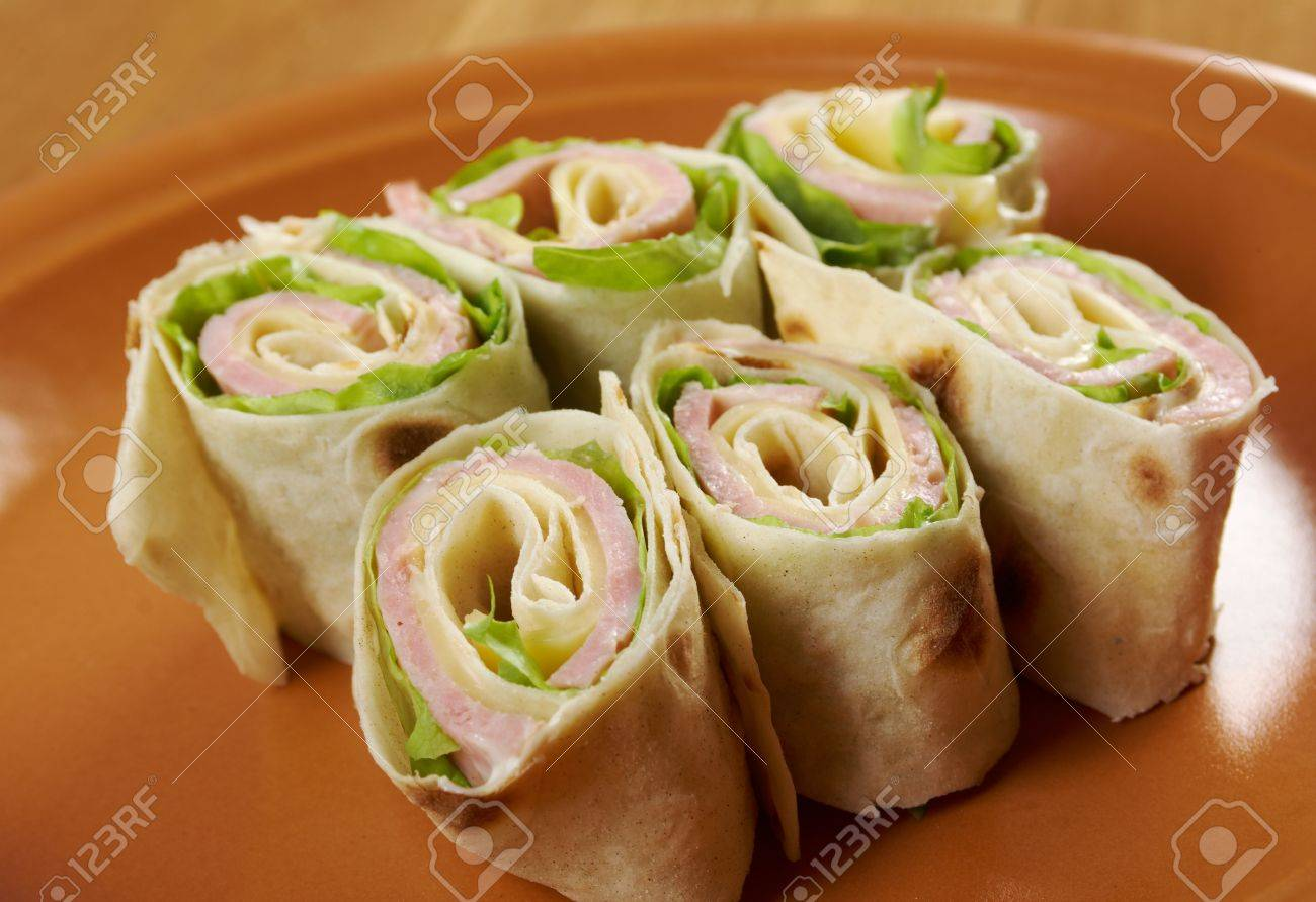 healthy club sandwich pita bread roll with cheese,ham,parsley Stock Photo - 19624389