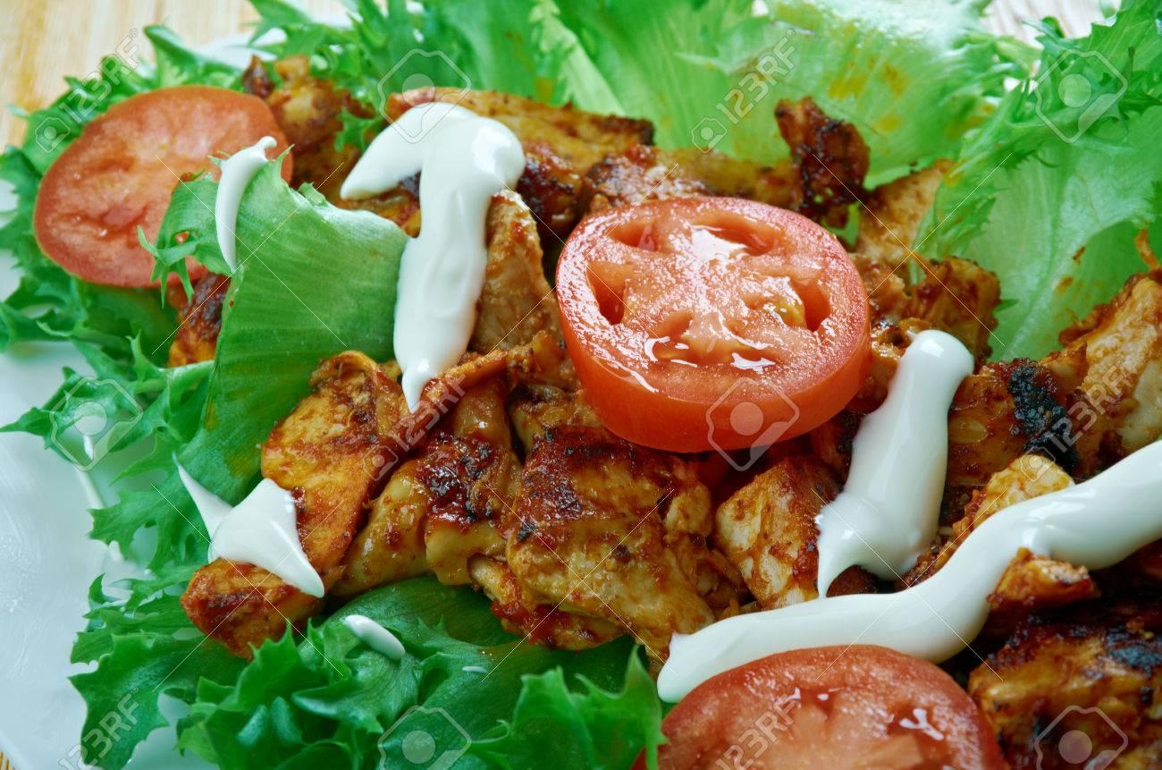 Jamaican jerk chicken lettuce wrapsribbean food stock photo jamaican jerk chicken lettuce wrapsribbean food stock photo 65294244 forumfinder Image collections