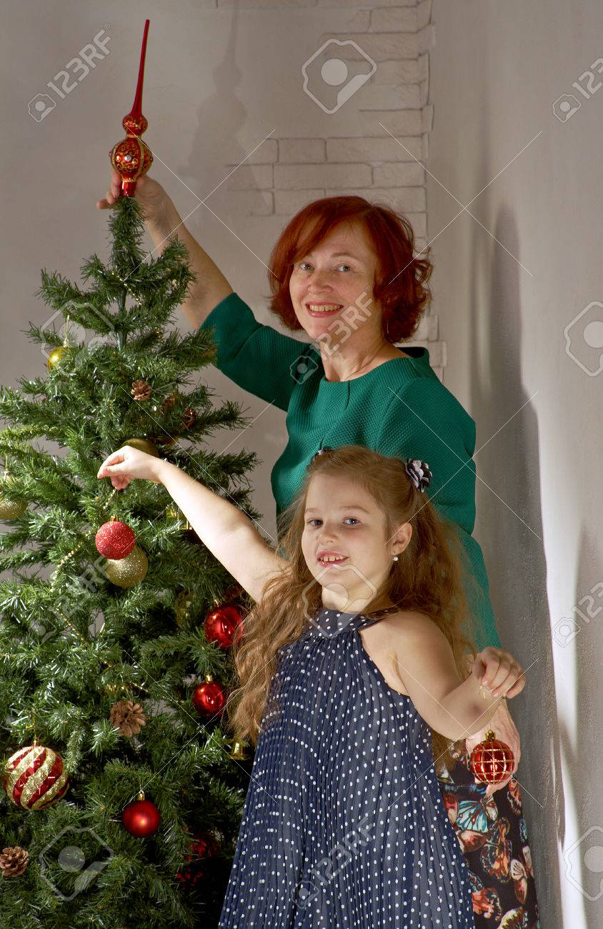 Happy Family Decorate Christmas Tree In Beautiful Living Room Stock Photo Picture And Royalty Free Image Image 66165951