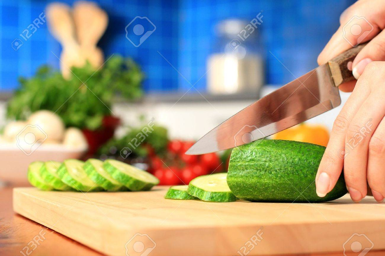 Female chopping food ingredients on the kitchen. Stock Photo - 7128997