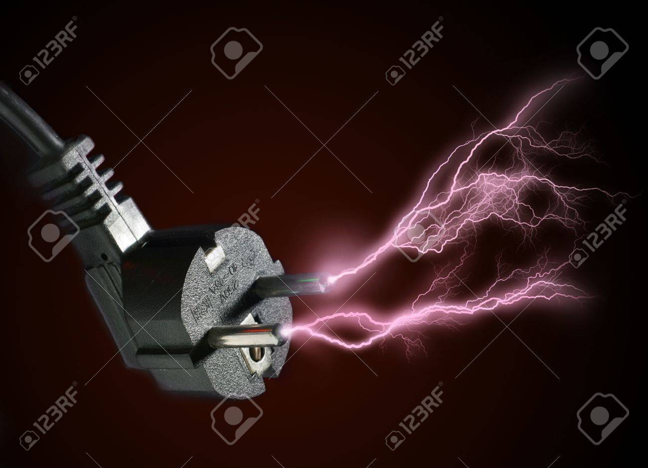 Plug and electric discharge over black background. Stock Photo - 8850752