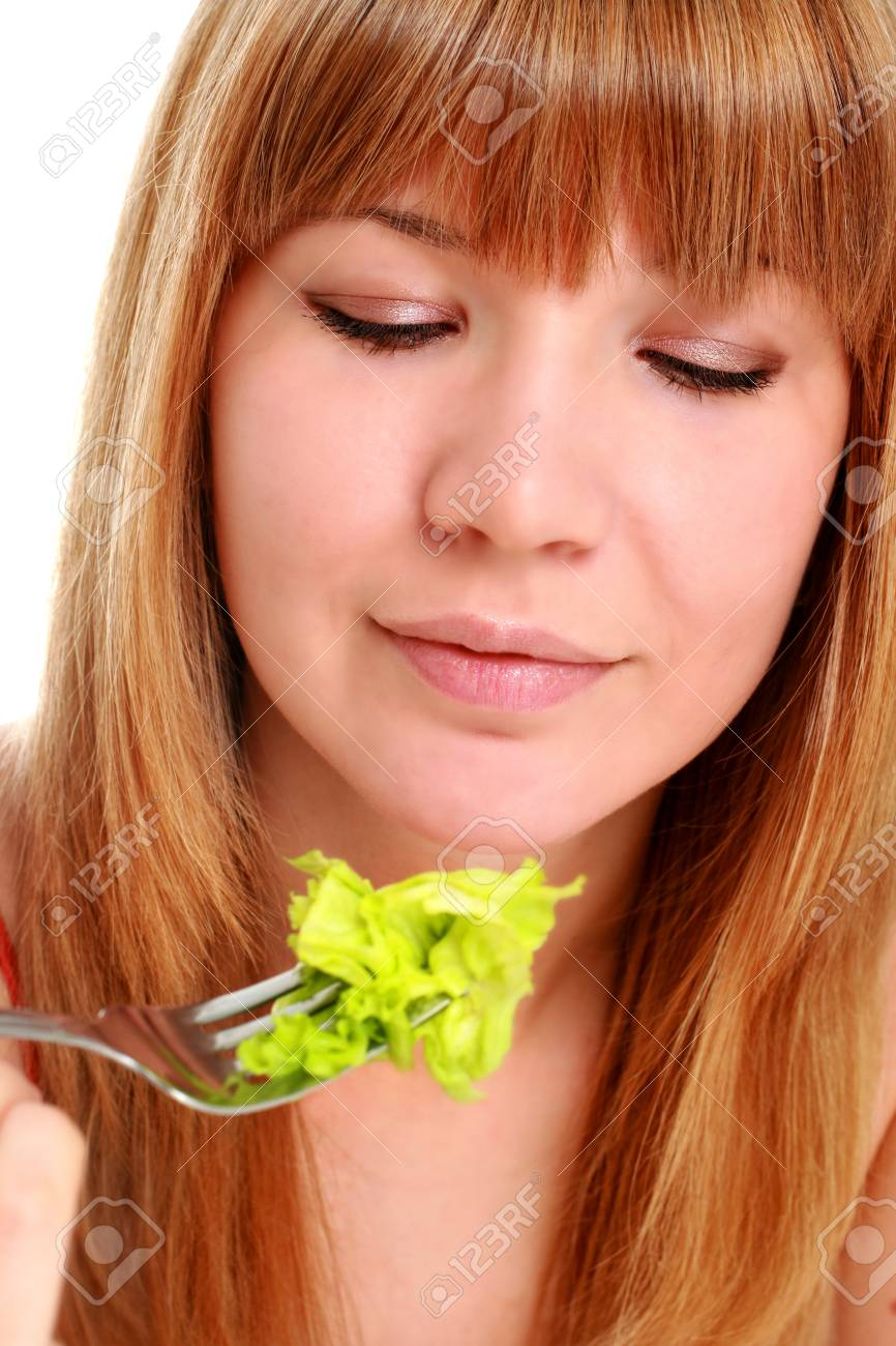 Healthy lifestyle concept. Girl with fork and salad isolated over white. Stock Photo - 8872086