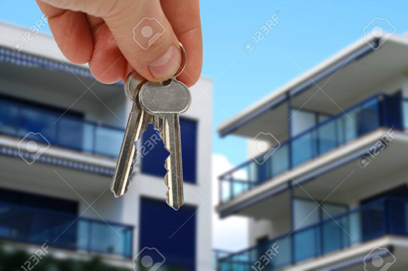 Key in hand from apartment over blue sky Stock Photo - 19050929