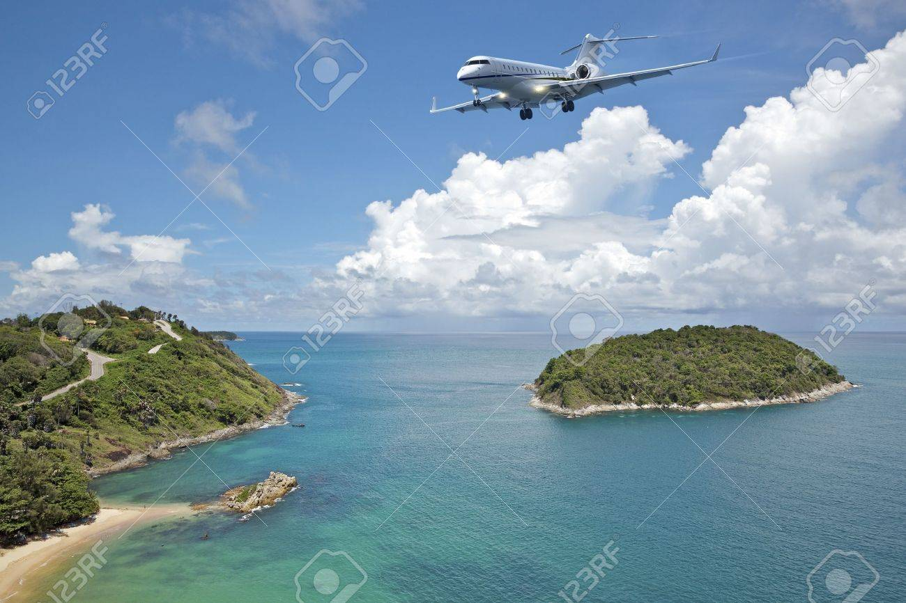 Private jet plane is going to land at the airport of a tropical island. Luxury style living concept. Stock Photo - 11802837
