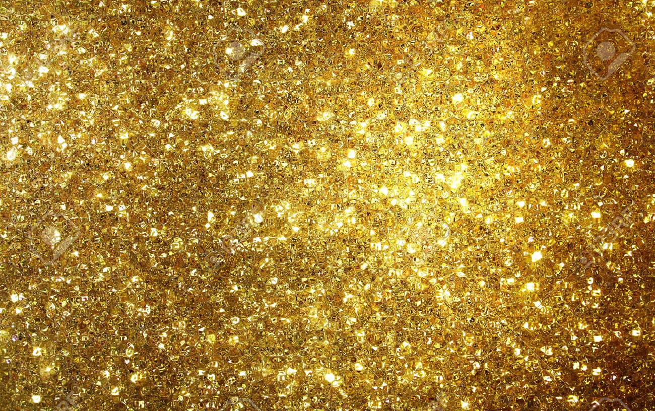 Golden Shimmer And Glitter Background Gold Wallpaper Stock Photo